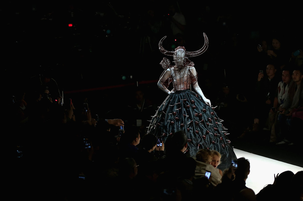 . A model showcases designs on the runway at Hu Sheguang Haute Couture Collection show during Mercedes-Benz China Fashion Week Spring/Summer 2014 at 751 D-PARK Workshop on October 29, 2013 in Beijing, China.  (Photo by Feng Li/Getty Images)