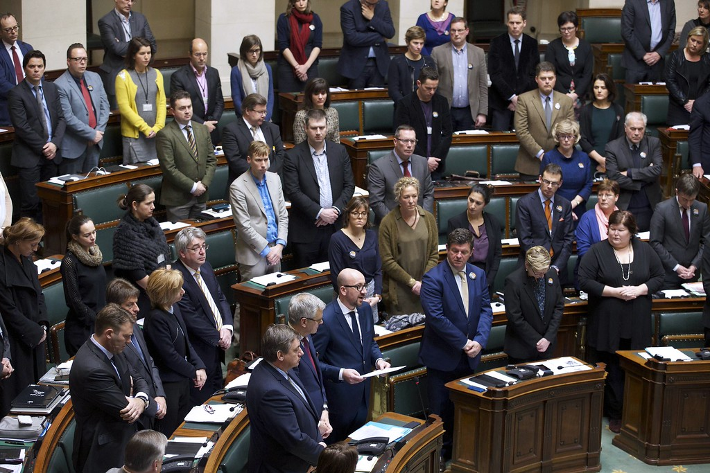 . Belgian Prime Minister Charles Michel (C) delivers a speech as Belgian MPs stand to pay tribute to people killed the day before in an attack by two armed gunmen on the offices of French satirical newspaper Charlie Hebdo, at the start of a plenary session at the federal parliament on January 8, 2015 in Brussels. A stunned and outraged France was in mourning yesterday, as security forces desperately hunted two brothers suspected of gunning down 12 people in an Islamist attack on a satirical weekly.  AFP PHOTO/BELGA/NICOLAS MAETERLINCK   /AFP/Getty Images