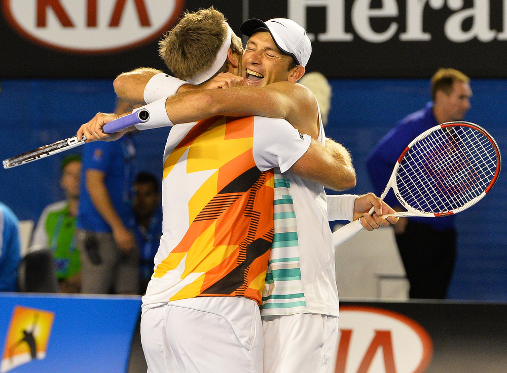 . Poland\'s Lukasz Kubot (R) and Sweden\'s Robert Lindstedt celebrate victory against Eric Butorac of the US and South Africa\'s Raven Klaasen during the men\'s doubles final on day 13 of the 2014 Australian Open tennis tournament in Melbourne on January 25, 2014. (SAEED KHAN/AFP/Getty Images)