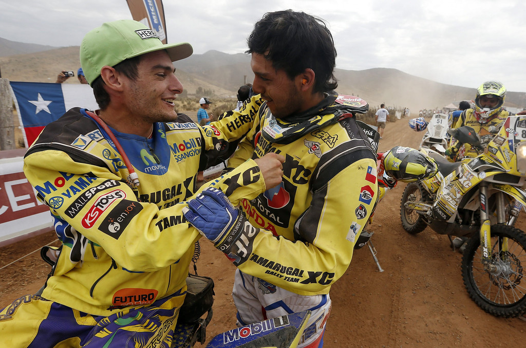 . Chilean Daniel Gouet (R) geets Chilean Ignacio Casale (L) after arriving to the finish line of the last stage of Rally Dakar 2014 at Illapel locality, 150 km from Valparaiso, Chile, 18 January 2014. The rally takes place in Argentina, Bolivia and Chile from 04 to 18 January 2014.  EPA/FELIPE TRUEBA