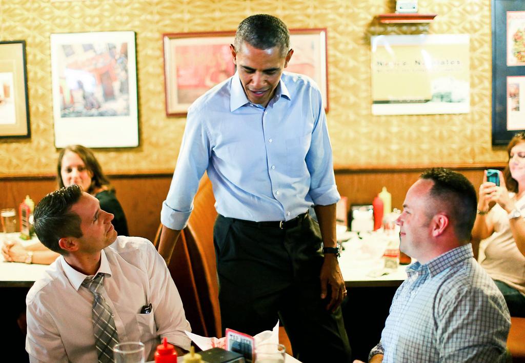 . President Barack Obama greets customers at Matt\'s Bar in Minneapolis on Thursday. (Pioneer Press: Ben Garvin)