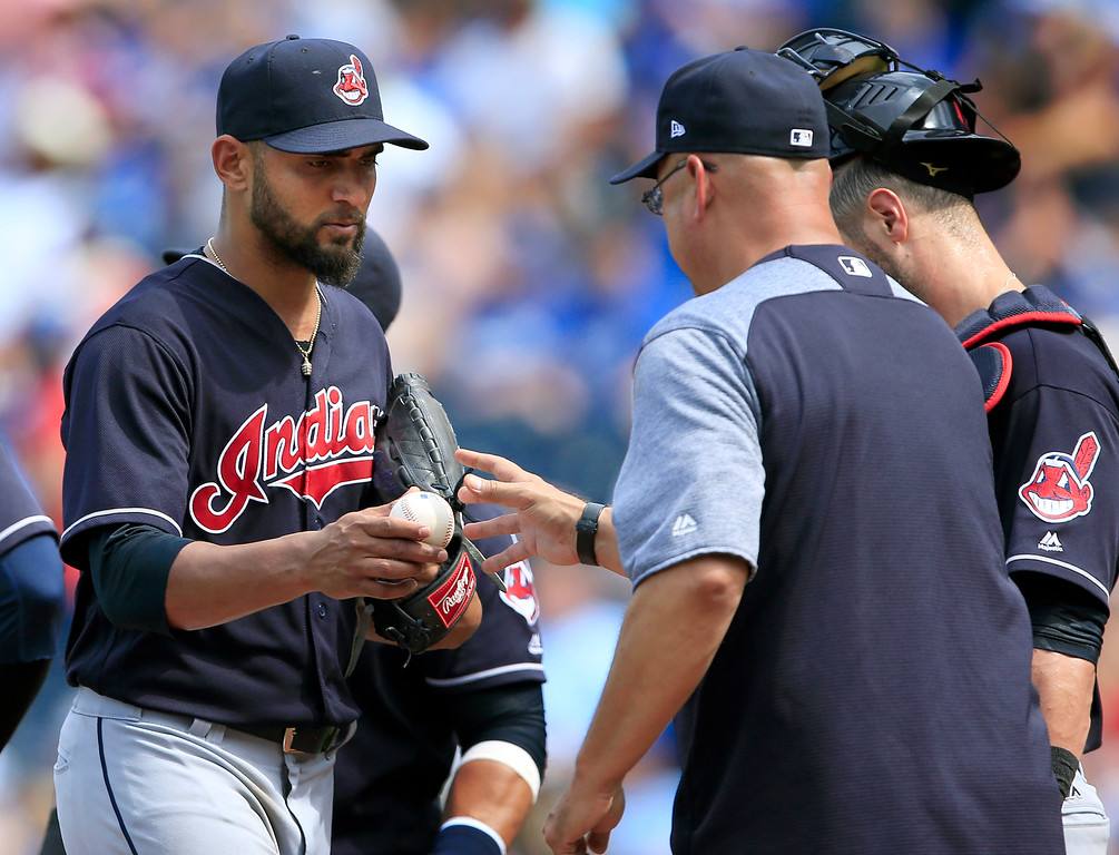 . Cleveland Indians starting pitcher Danny Salazar, left, hands the ball to manager Terry Francona, right, during the fifth inning of a baseball game against the Kansas City Royals at Kauffman Stadium in Kansas City, Mo., Sunday, Aug. 20, 2017. (AP Photo/Orlin Wagner)