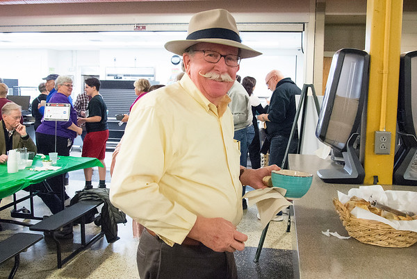 01/30/20 Wesley Bunnell | StaffrrThe annual SOUPerBowl to benefit the Friendship Centers Soup Kitchen took place on Thursday Jan 30, 2020 at E.C. Goodwin Technical School. John Whalen smiles as he carries his soup bowl and bread back to his table.