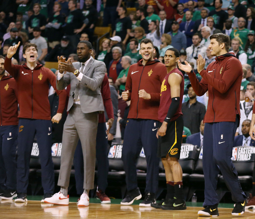 . Players on the Cleveland Cavaliers bench cheer their teammates during the second half in Game 7 of the NBA basketball Eastern Conference finals against the Boston Celtics, Sunday, May 27, 2018, in Boston. (AP Photo/Elise Amendola)