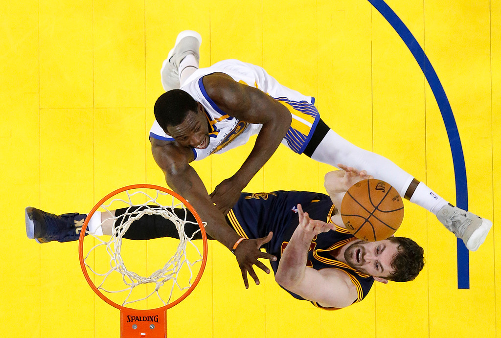 . Golden State Warriors forward Draymond Green, top, defends a shot by Cleveland Cavaliers forward Kevin Love during the second half of Game 1 of basketball\'s NBA Finals in Oakland, Calif., Thursday, June 1, 2017. (John G. Mabanglo/Pool Photo via AP)