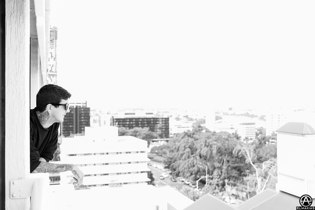 Austin Carlile looking off the balcony of his room - Soundwave Festival 2013