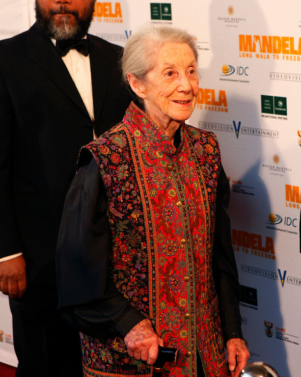 """. In this photo taken Sunday, Nov. 3, 2013, Nobel Priize winning author  Nadine Gordimer, arrives for the South African premier of the movie \""""Mandela - Long Walk To Freedom\"""" in Johannesburg. Gordimer died peacefully in her sleep Sunday, July 13, 2014 aged 90, her family said Monday. (AP Photo/Denis Farrell)"""