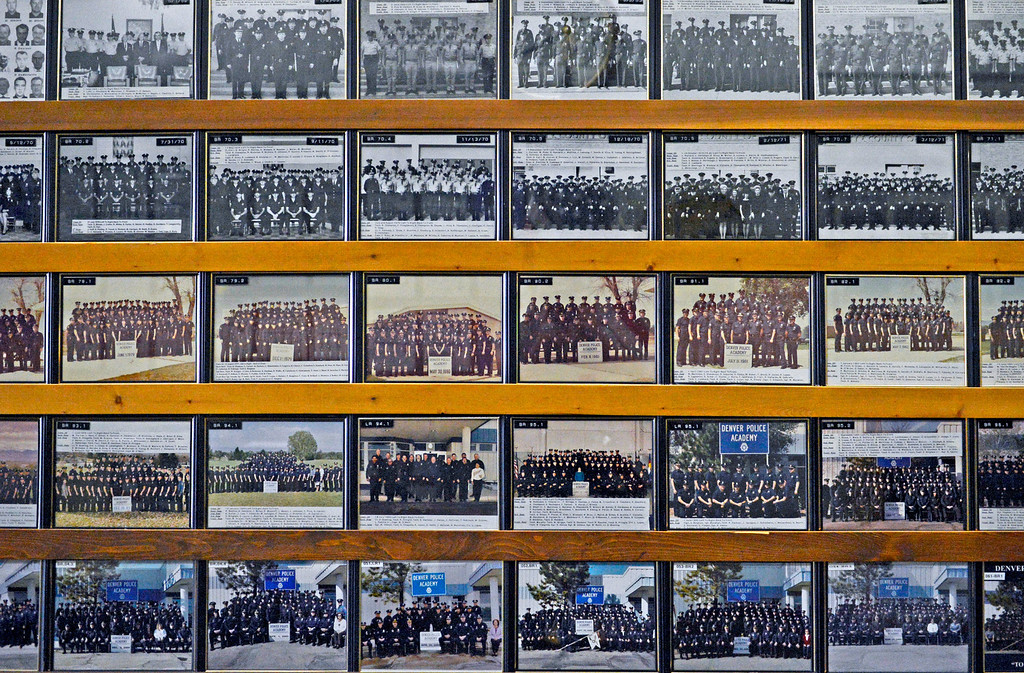 . Photos of classes from Denver Police Academy line the hallway of the training building, April 29, 2013. (Photo By RJ Sangosti/The Denver Post)