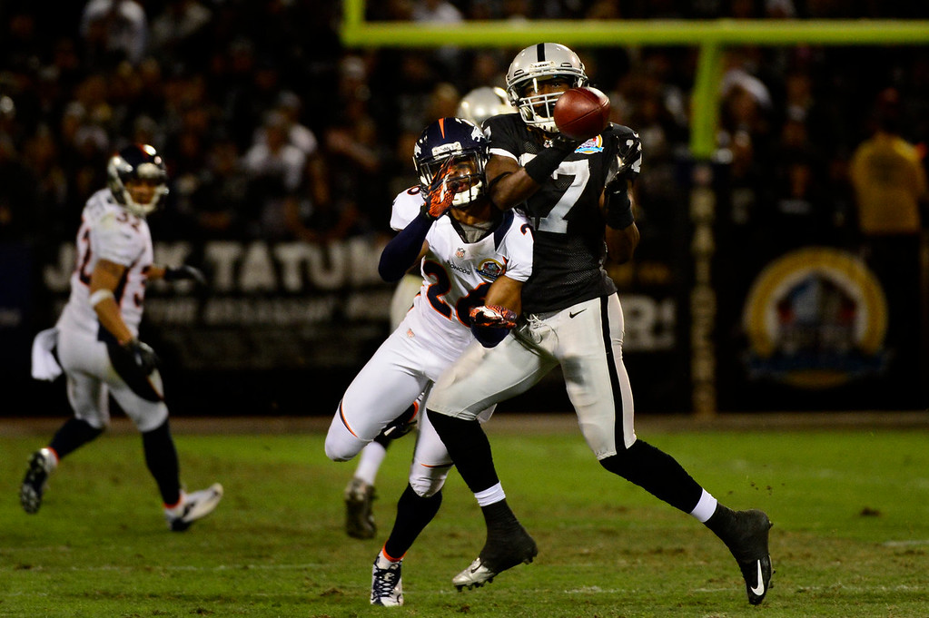 . Denver Broncos free safety Rahim Moore #26 makes a big hit on Oakland Raiders wide receiver Denarius Moore #17 to knock the ball away on first and 10 at the O.co Coliseum, in Oakland , CA December 06, 2012.      Joe Amon, The Denver Post