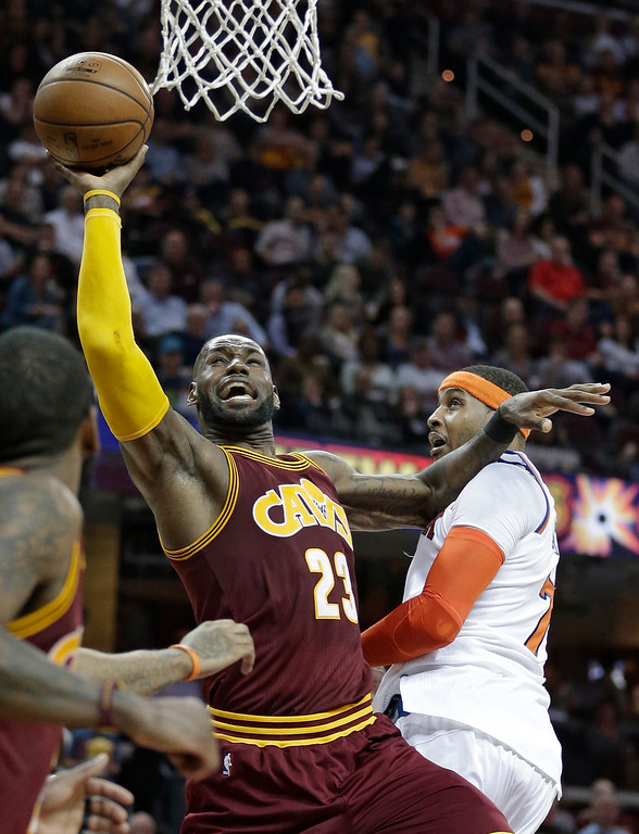 . Cleveland Cavaliers\' LeBron James (23) drives to the basket against New York Knicks\' Carmelo Anthony (7) in the first half of an NBA basketball game, Thursday, Feb. 23, 2017, in Cleveland. (AP Photo/Tony Dejak)