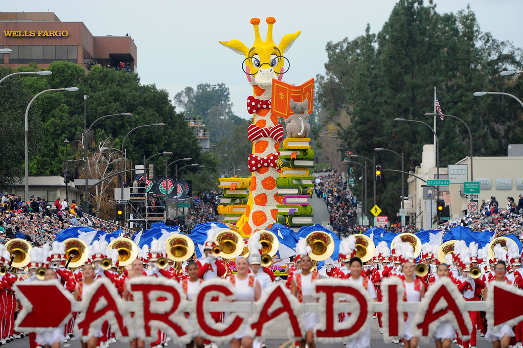 ". The The UPS Store Inc., ""Books Bring Us Together\"" float, winner of the I Isabella Coleman Trophy, follows the Arcadia High School band during the 128th Rose Parade in Pasadena, Calif., Monday, Jan. 2, 2017. (AP Photo/Michael Owen Baker)"