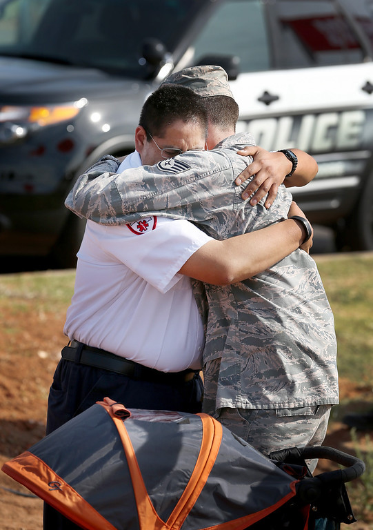 . During the remembrance ceremony for the victims of last year\'s tornado, Oklahoma City paramedic Stephen Bagay (L) is hugged by Max Broderick on May 20, 2014 in Moore, Oklahoma.  On May 20, 2013 a two-mile wide EF5 tornado touched down in the town killing 24 people and leaving behind extensive damage to homes and businesses.  (Photo by Joe Raedle/Getty Images)