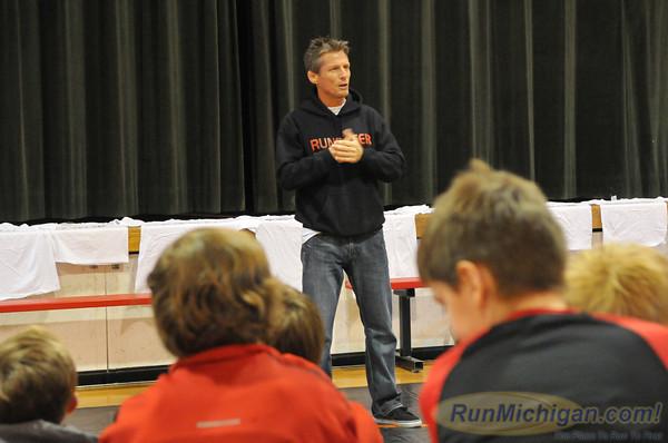 Todd Williams talks with students at St. Regis School