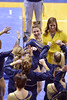 MORGANTOWN, WV - MARCH 8: WVU female gymnast Beth Deal is greeted and congratulated by teammates following her beam performance at a dual meet March 8, 2015 in Morgantown, WV.