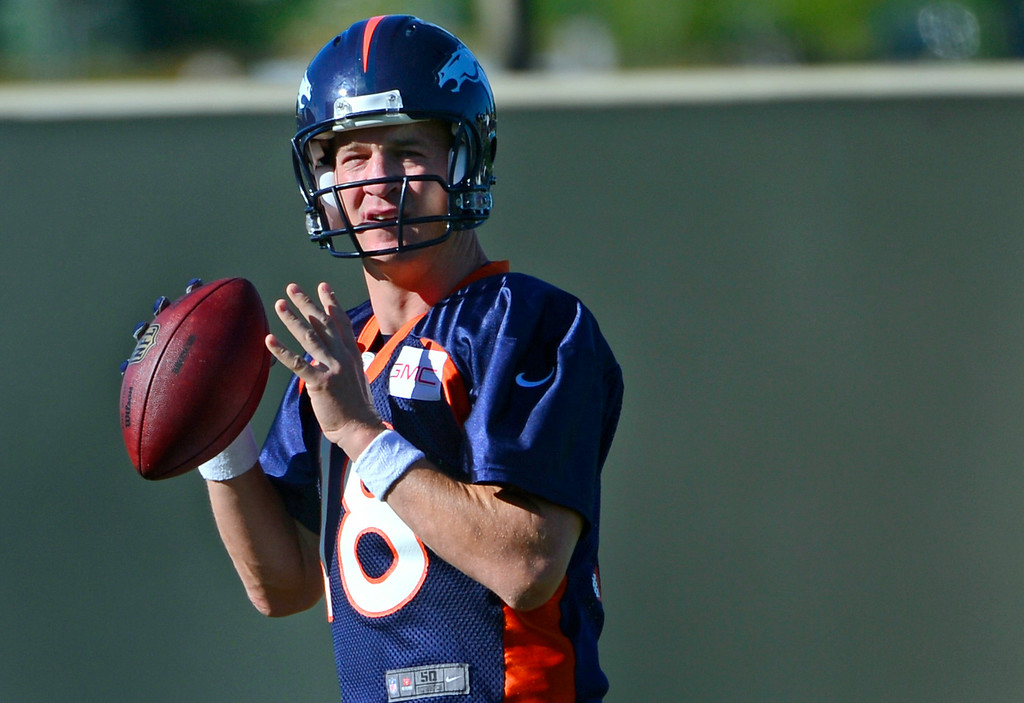 . Quarterback Peyton Manning joins the other passers at the start of practice. The Denver Broncos football team gets in their final day of practice during training camp at Dove Valley  on Friday, Aug. 15, 2014. (Photo by Kathryn Scott Osler/The Denver Post)