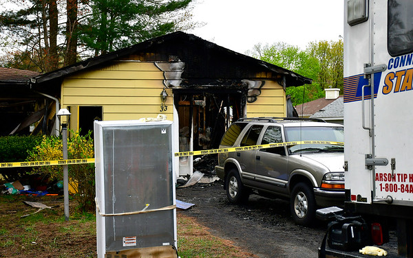 5/1/2019 Mike Orazzi | Staff The scene of a house fire at 33 Hardwood Drive in Plainville on Wednesday morning.