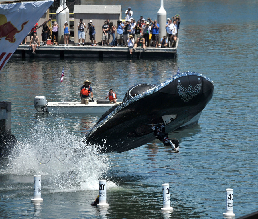 """. LONG BEACH, CALIF. USA -- Shane Passantino pilots \""""Three Amigos\"""" during the Flugtag in Rainbow Harbor in Long Beach, Calif. on August 21, 2010. Thirty five teams competed in the Red Bull event where teams build homemade, human-powered flying machines and pilot them off a 30-foot high deck in hopes of achieving flight.  Flugtag means \""""flying day\"""" in German. They are on distance, creativity and showmanship..Photo by Jeff Gritchen / Long Beach Press-Telegram.."""