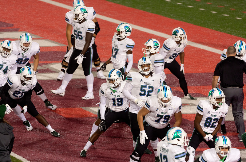 Tulane back on the field.  Doing stretching exercises.