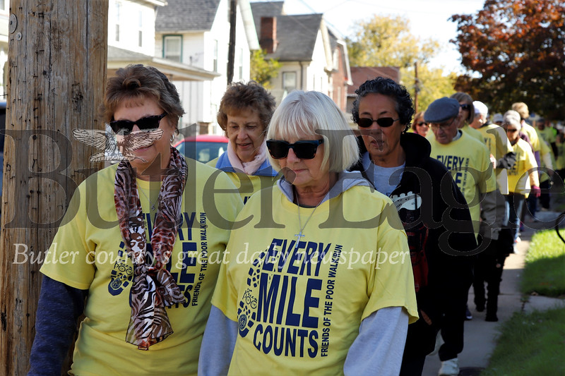 St. Vincent de Paul Friends of the Poor walkers walk down East Brady St. in Butler Saturday. Seb Foltz/Butler Eagle