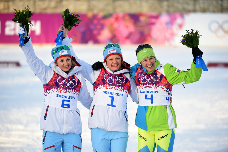 . (L-R) Silver medalist Ingvild Flugstad Oestberg of Norway, gold medalist Maiken Caspersen Falla of Norway and bronze medalist Vesna Fabjan of Slovenia celebrate on the podium during the flower ceremony for the Finals of the Ladies\' Sprint Free during day four of the Sochi 2014 Winter Olympics at Laura Cross-country Ski & Biathlon Center on February 11, 2014 in Sochi, Russia.  (Photo by Harry How/Getty Images)