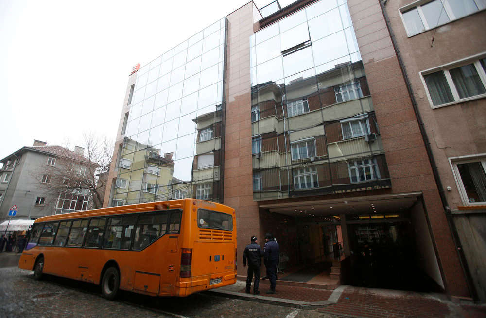 . A bus with Bulgarian police is parked outside the office of Czech power group CEZ in Sofia February 19, 2013. Bulgaria\'s Prime Minister Boiko Borisov sought to calm mass protests on Tuesday by promising to slash electricity prices and punish foreign-owned power companies, setting Bulgaria on a collision course with EU partner the Czech Republic. Borisov said the distribution license of central Europe\'s largest listed company, Czech-based CEZ would be revoked.   REUTERS/Stoyan Nenov