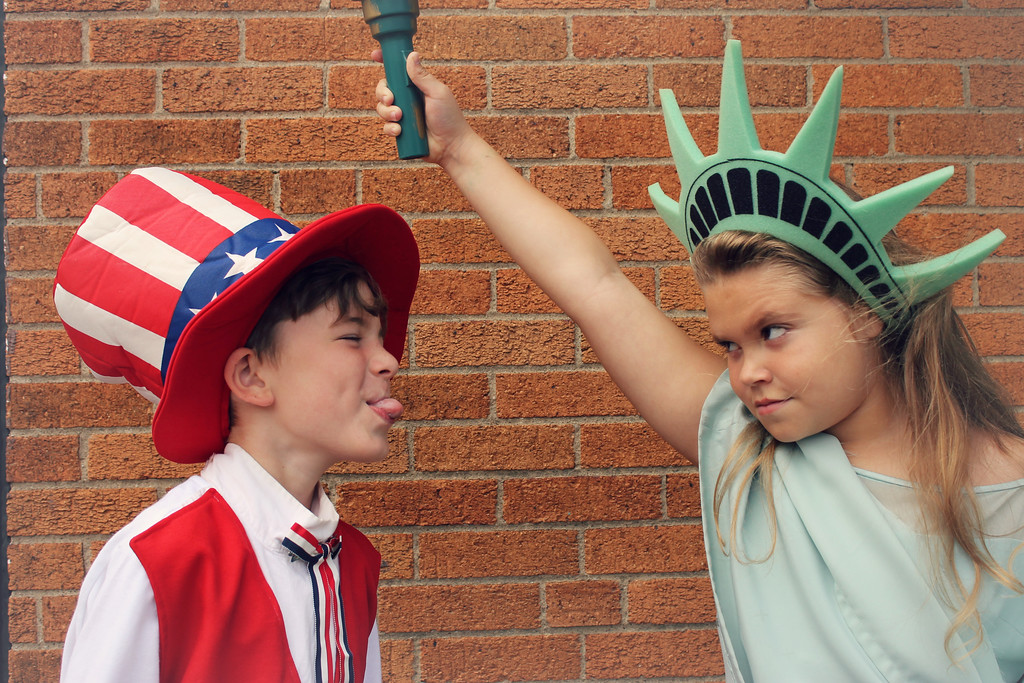 """. Yankee Doodle Boy (Lukas Reel) and Statue of Liberty (Jacqueline Kriz) are fighting as Uncle Sam tries to organize the parade for \""""A Salute to America,\"""" the show that concludes Geauga Lyric Theater Guild\'s summer youth programming. It\'s on stage at 7:30 p.m. July 19 and 20. For more information, visit www.geaugatheater.org. (Submitted)"""