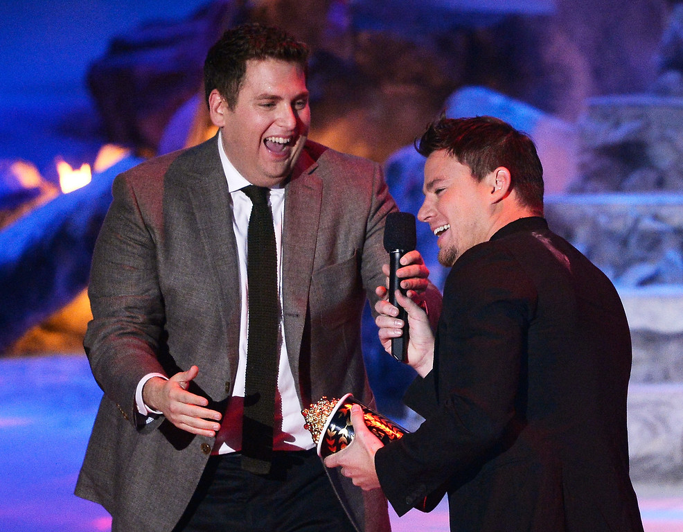 . Actor Jonah Hill (L) presents the Trailblazer Award to honoree Channing Tatum onstage at the 2014 MTV Movie Awards at Nokia Theatre L.A. Live on April 13, 2014 in Los Angeles, California.  (Photo by Kevork Djansezian/Getty Images for MTV)