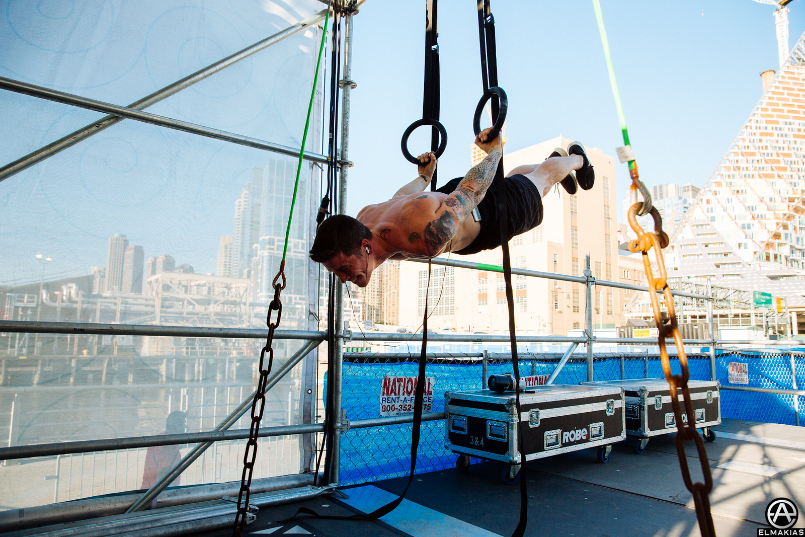 Zack of All Time Low working out on sidestage