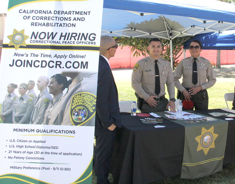 Representatives from the California Department of Corrections host a booth in the CSS Lawn.