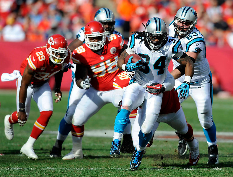 . Carolina Panthers running back DeAngelo Williams runs for a first down against the Kansas City Chiefs during the first half of their NFL football game in Kansas City, Missouri December 2, 2012. REUTERS/Dave Kaup