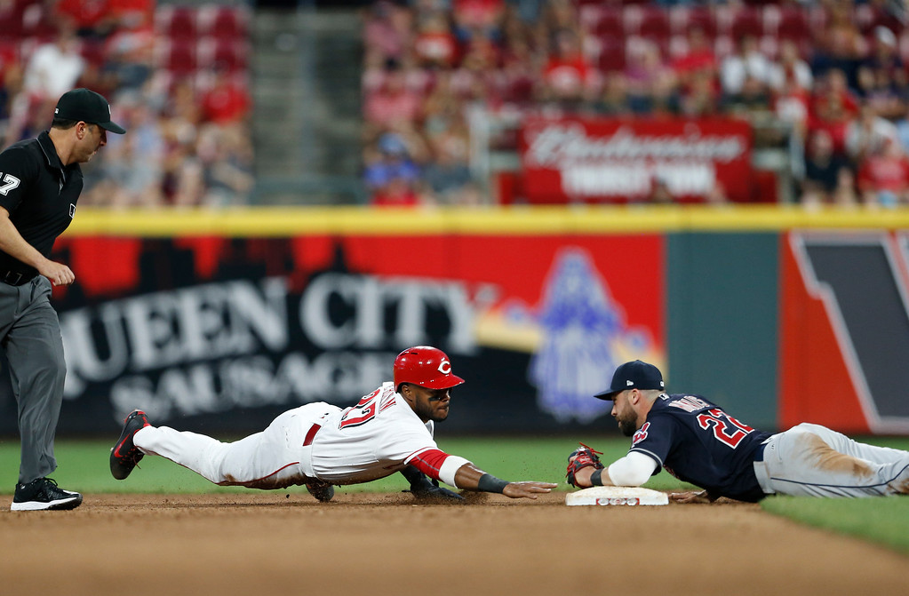 . Cincinnati Reds\' Phillip Ervin, left, is safe at second with a steal as Cleveland Indians second baseman Jason Kipnis (22) can\'t make the tag during the fourth inning of a baseball game, Monday, Aug. 13, 2018, in Cincinnati. (AP Photo/Gary Landers)
