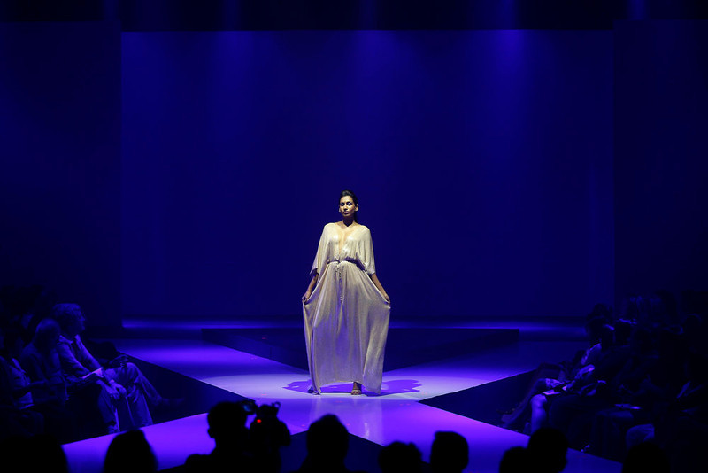 . In this Wednesday, April 3, 2013 photo, a Sri Lankan model presents a creation by Aqua during the Colombo Fashion Week in Colombo, Sri Lanka. (AP Photo/Eranga Jayawardena)