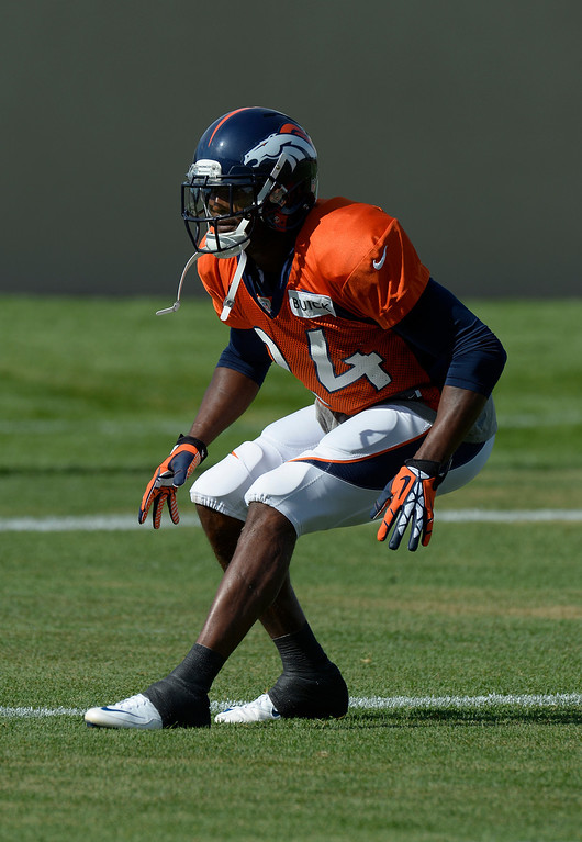 . Denver Broncos CB Champ Bailey (24) runs through drills during training camp August 6, 2013 at Dove Valley. (Photo By John Leyba/The Denver Post)