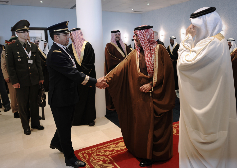 . Bahraini Crown Prince Salman bin Hamad Al-Khalifa (2R) is welcomed by officers during the opening of the Bahrain International Airshow 2014, in Sakhir, south of the capital Manama, on January 16, 2014. (MOHAMMED AL-SHAIKH/AFP/Getty Images)