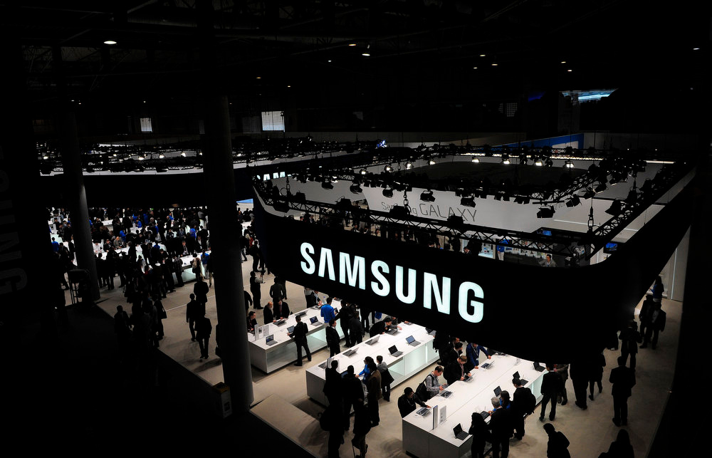 . A view of the visitors at the Samsung stand during the Mobile World Congress, the world\'s largest mobile phone trade show, in Barcelona, Spain, Tuesday, Feb. 26, 2013. (AP Photo/Manu Fernandez)
