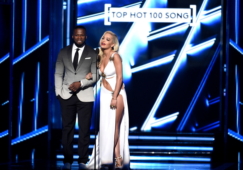 . 50 Cent, left, and Rita Ora present the award for top hot 100 song at the Billboard Music Awards at the MGM Grand Garden Arena on Sunday, May 17, 2015, in Las Vegas. (Photo by Chris Pizzello/Invision/AP)