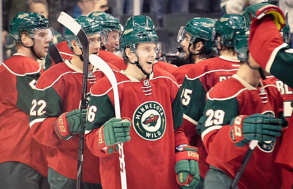 . Minnesota Wild players celebrate after beating the St. Louis Blues 4-2.(Pioneer Press: Ben Garvin)