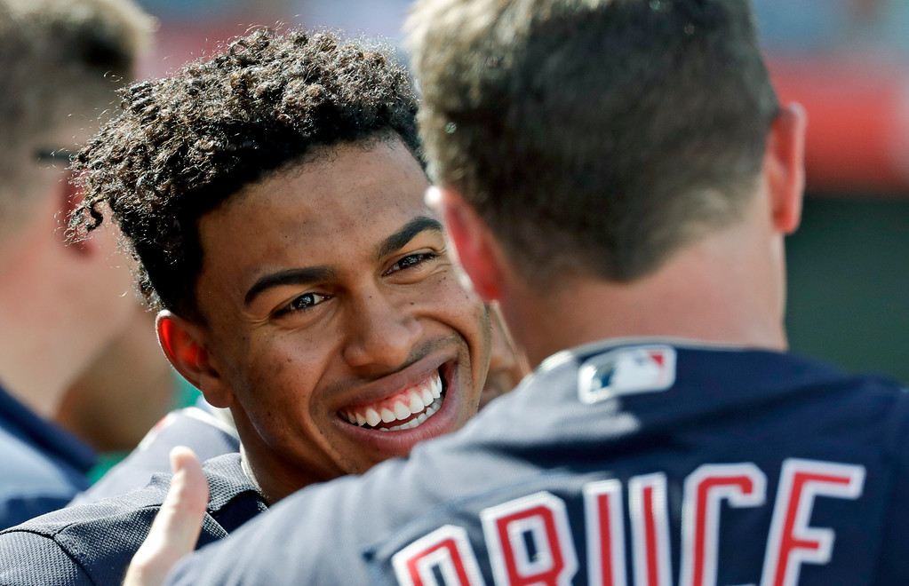 . Cleveland Indians shortstop Francisco Lindor, left, talks with right fielder Jay Bruce on the bench during the sixth inning of a baseball game against the Los Angeles Angels in Anaheim, Calif., Thursday, Sept. 21, 2017. (AP Photo/Chris Carlson)