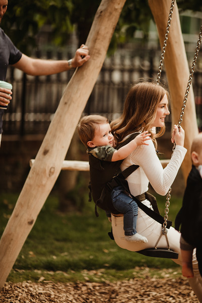Izmi_Baby_Carrier_Olive_Lifestyle_Back_Carry_Swing_Profile.jpg