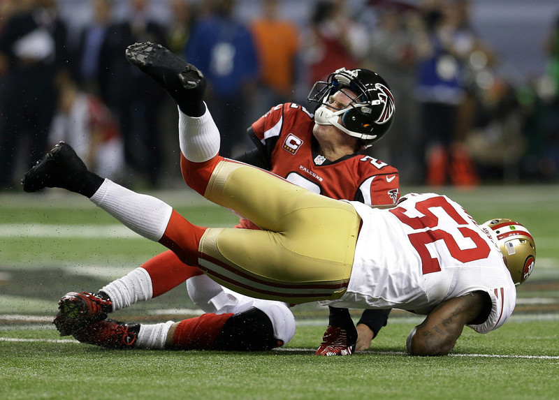 . San Francisco 49ers\' Patrick Willis (52) tackles Atlanta Falcons\' Matt Ryan (2) after a short run during the second half of the NFL football NFC Championship game Sunday, Jan. 20, 2013, in Atlanta. (AP Photo/Mark Humphrey)