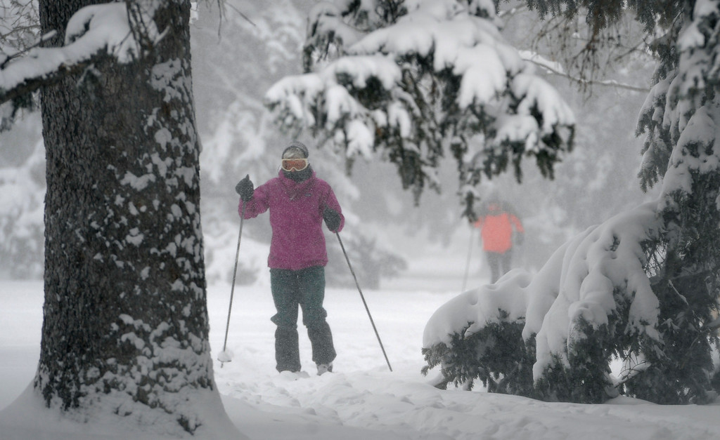 . DENVER, CO.- MARCH 23: A pair of cross country skiers make their way down the center of 17th Ave. Parkway in Park Hill. Snow arrived overnight in Denver and for much of Colorado with a foot or more expected in some areas of the foothills and eastern planes. (Photo By Kathryn Scott Osler/The Denver Post)