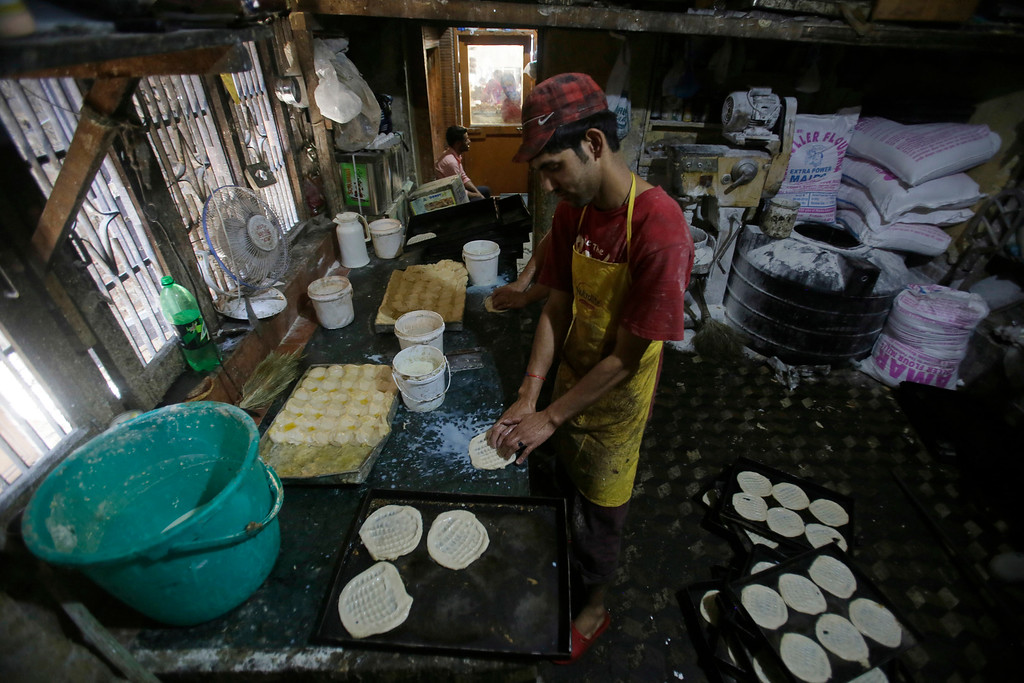 . A Kashmiri baker prepares traditional bread for sale ahead of Eid al-Fitr in Srinagar, Indian controlled Kashmir Wednesday, June 13, 2018. Eid al-Fitr marks the end of the fasting month of Ramadan. (AP Photo/Mukhtar Khan)