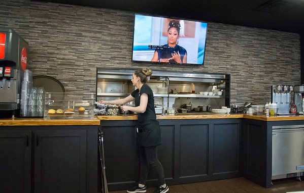 02/28/20 Wesley Bunnell | Staff Emily Carlson picks up a customers order from the kitchen window at Joey B's Restaurant on Friday afternoon. The restaurant which recently held its soft opening is slated to officially open with a ribbon cutting mid April.