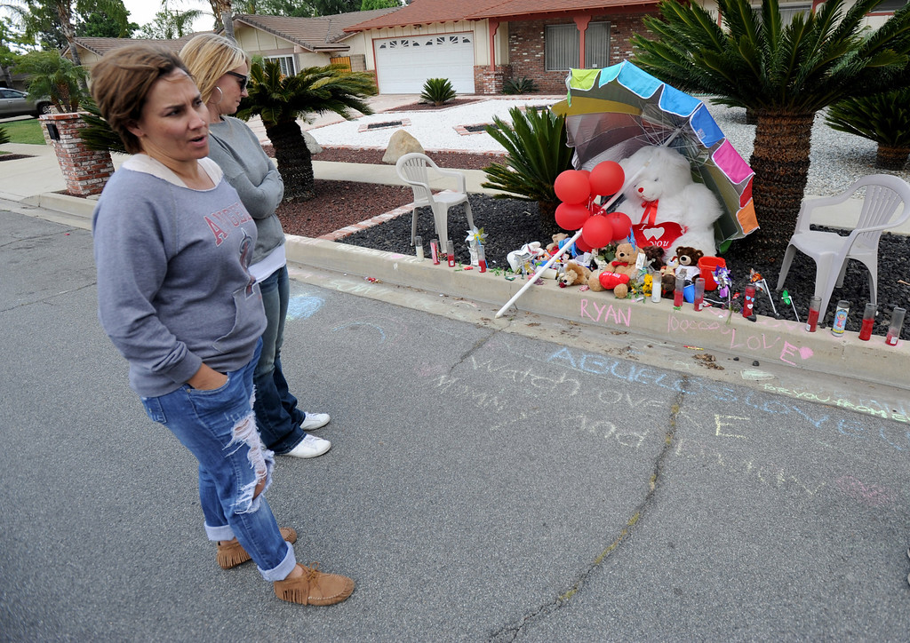 . A memorial sits along Alta Loma Drive for Ryan Cruz Saldana, 3, a resident of South Pasadena, who was hit by a truck and killed Friday, near the intersection of Alta Loma Drive and Garnet Street. (Photo by John Valenzuela/Inland Valley Daily Bulletin)