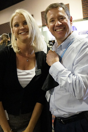Sony rep posing with her customer.