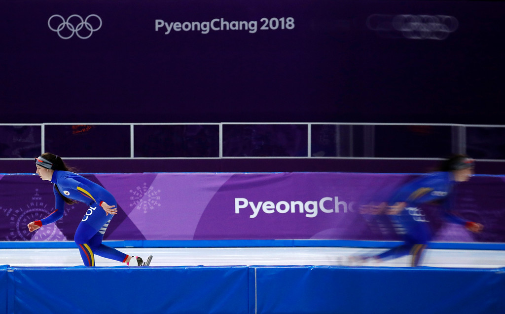 . Laura Isabel Gomez Quintero of Colombia is reflected in a TV screen during a speedskating practice session at the Gangneung Oval at the 2018 Winter Olympics in Gangneung, South Korea, Thursday, Feb. 22, 2018. (AP Photo/John Locher)