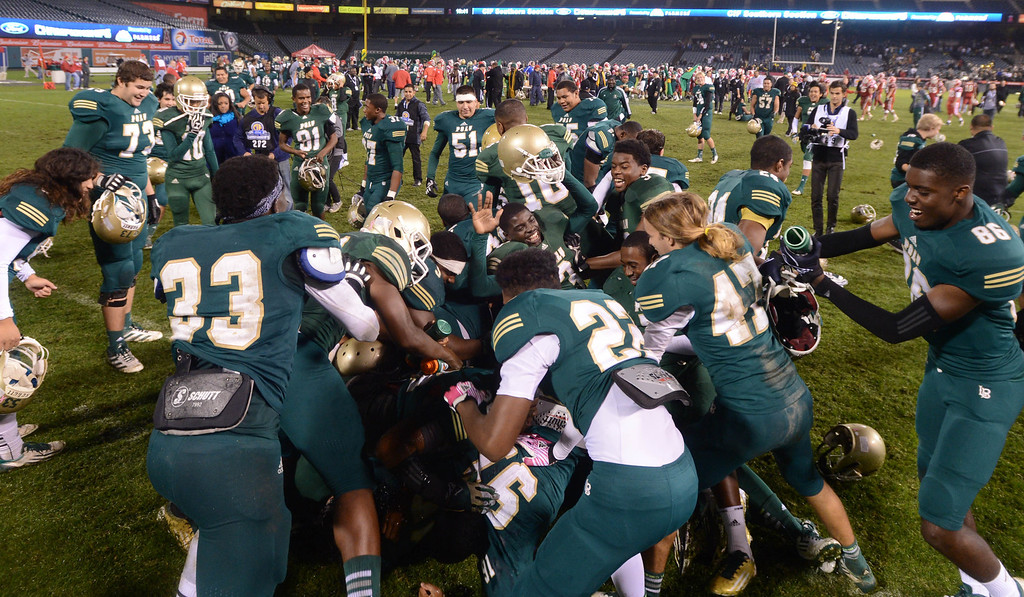 . Anaheim, Calif., --12-01-12 - Long Beach Poly celebrates  after they defeated Mater Dei  for the CIF-SS Pac-5 Division championship, at Anaheim Stadium.   Stephen Carr/  LANG