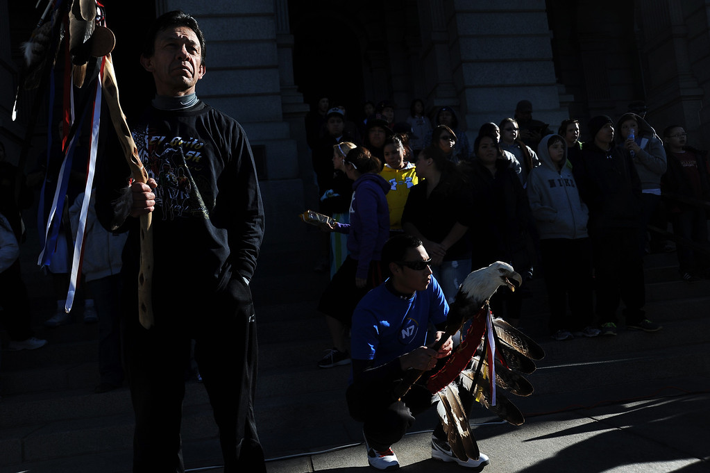 . DENVER, CO--NOVEMBER 26, 2011--Nick Diaz, left, and Kaden Walks Nice stand in front of runners and walkers Nov. 26, 2011 during the closing ceremony of the final day of the 13th Annual Sand Creek Massacre Spiritual Healing Run in Denver that started at the Sand Creek Massacre National Historic Site and ended on the west steps of the State Capitol Building.   Photo by Leah Millis/Special to The Denver Post