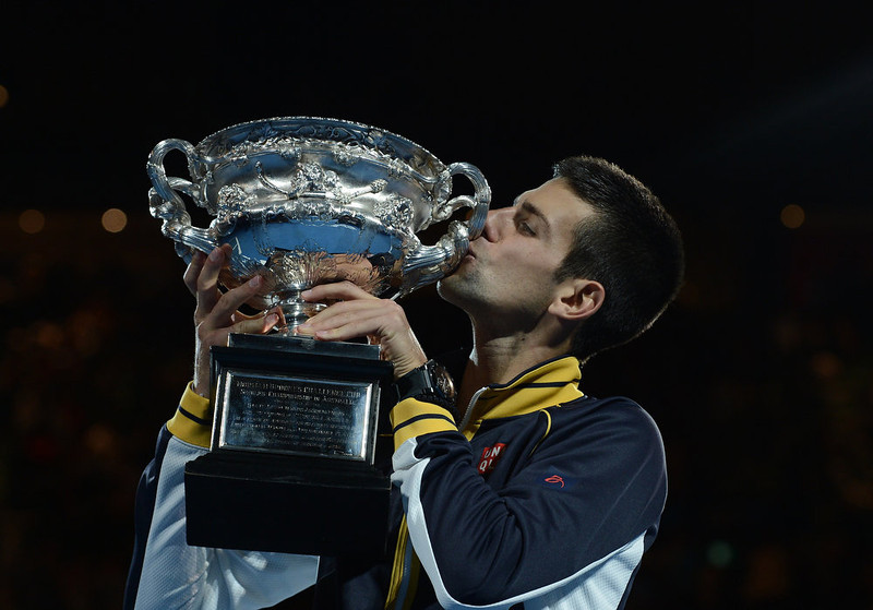 . Serbia\'s Novak Djokovic poses with the winner\'s trophy after his victory over Britain\'s Andy Murray during the men\'s singles final on day 14 of the Australian Open tennis tournament in Melbourne on January 27, 2013. MANAN VATSYAYANA/AFP/Getty Images