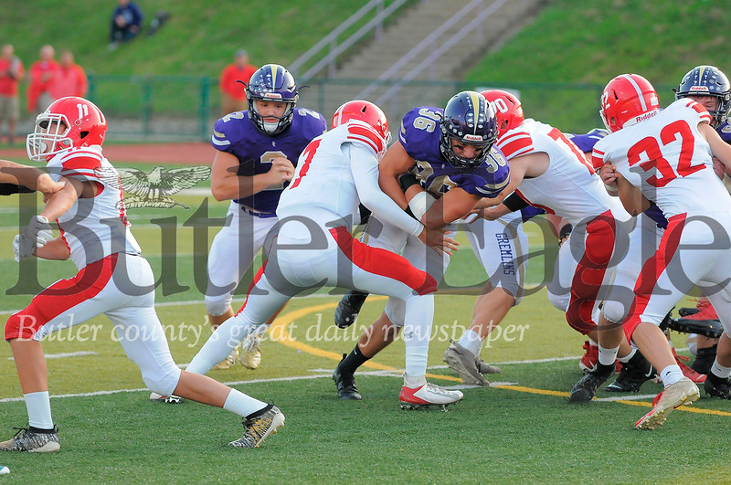 Karns City #36  Mitchell Kelsea runs the ball as Punxsutawney #70 Josh Miller and #7 Kameron Flagoo try to block during a game at Deihl Stadium on Friday August 30, 2019 (Jason Swanson photo)